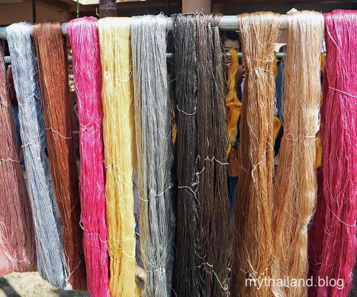 Dyed silk yarn hangs in Ban Phon